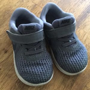 Worn toddler Nike shoes